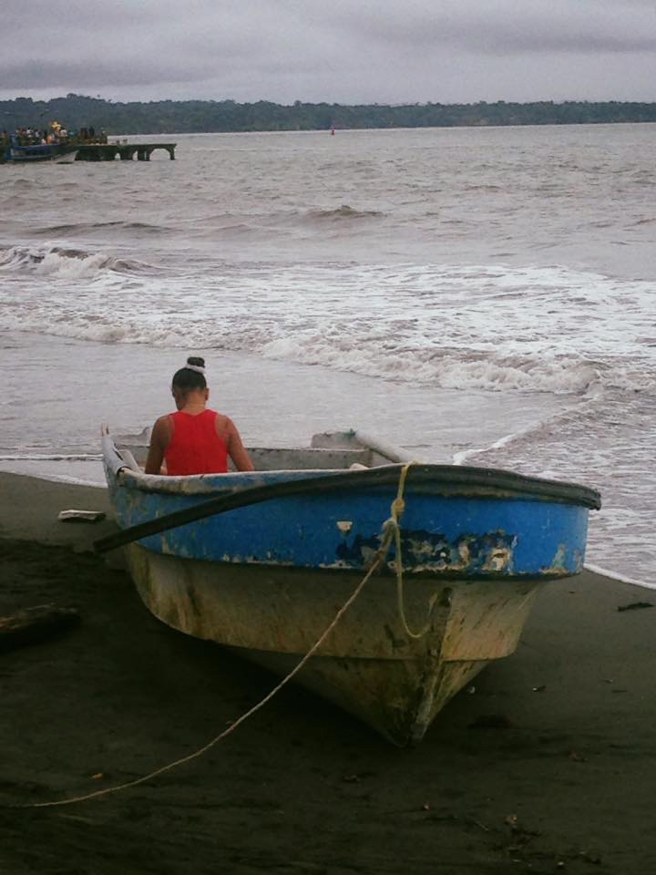 frontier-free-drifting-juanchaco-colombia-girl-in-red-in-boat