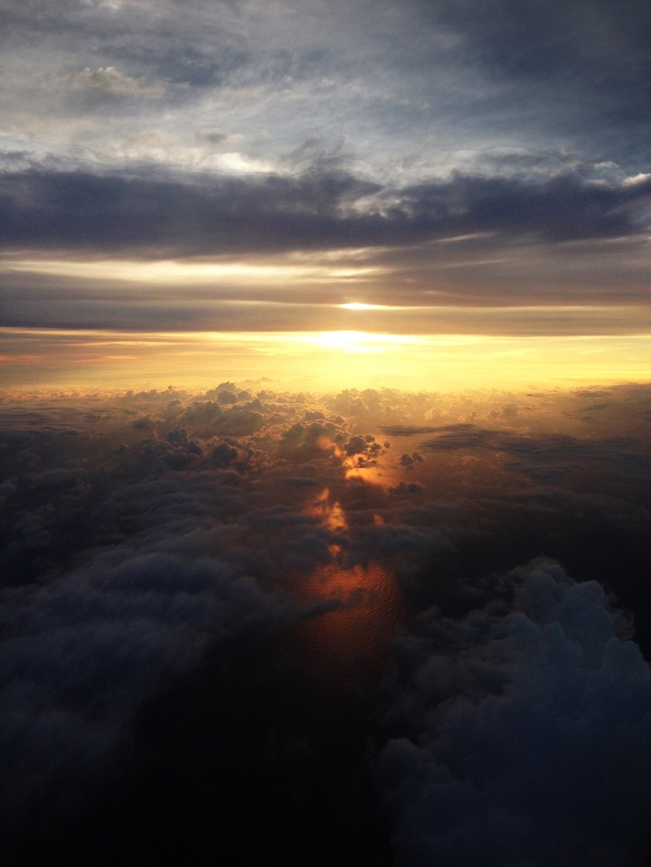 frontier-free-drifting-san-jose-sun-setting-from-plane